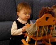 Audrey investigates one of Nana's dolls