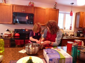Making cupcakes: showing Sienna how to break an egg