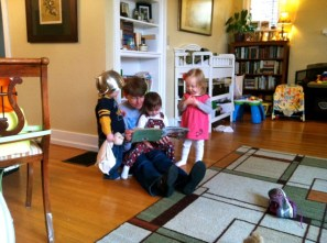 Ooma reads to all three (and a helmet)
