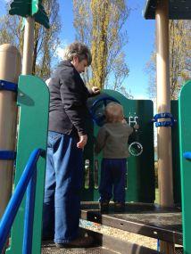Nana helps Jamie spin the wheel.