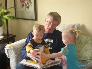 "Grampy reads ""Where's Spot?"" with Jamie and Theresa."
