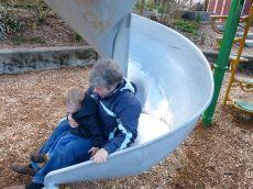 Nana and Jamie down the twisty slide!