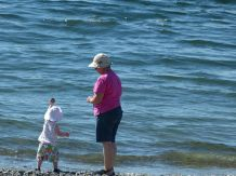 Throwing rocks in the water with Nana