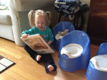 Theresa reads to her bunny on the potty, just as we read to her on the potty.