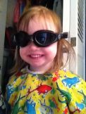 Audrey wanted to try on Daddy's goggles.