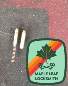 On the left is a Baldwin or Emtek cylinder cap retainer pin, and on the right is a Schlage pin. Note the wear that is apparent on the smaller pin to the left.