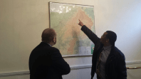 Ciaran Staunton (Fingal) and the Ambassador of Lesotho to Ireland, His Excellency Mr. Paramente Phamotse check out the relief map of Lesotho at the Lesotho Embassy in Ireland.