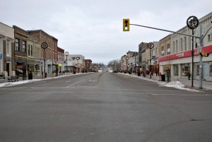 An empty street in the middle of a small town.