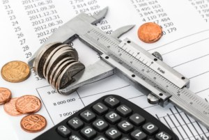 Calculating wealth with calculator, coins and spreadsheet