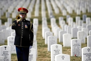 Memorial Day - Soldier playing Taps at a Veteran's cemetery
