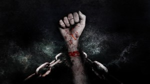 Fist breaking forcefully through a chain