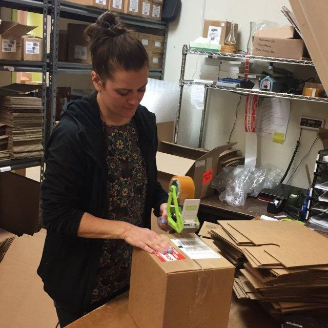 Nicole preparing a shipment.