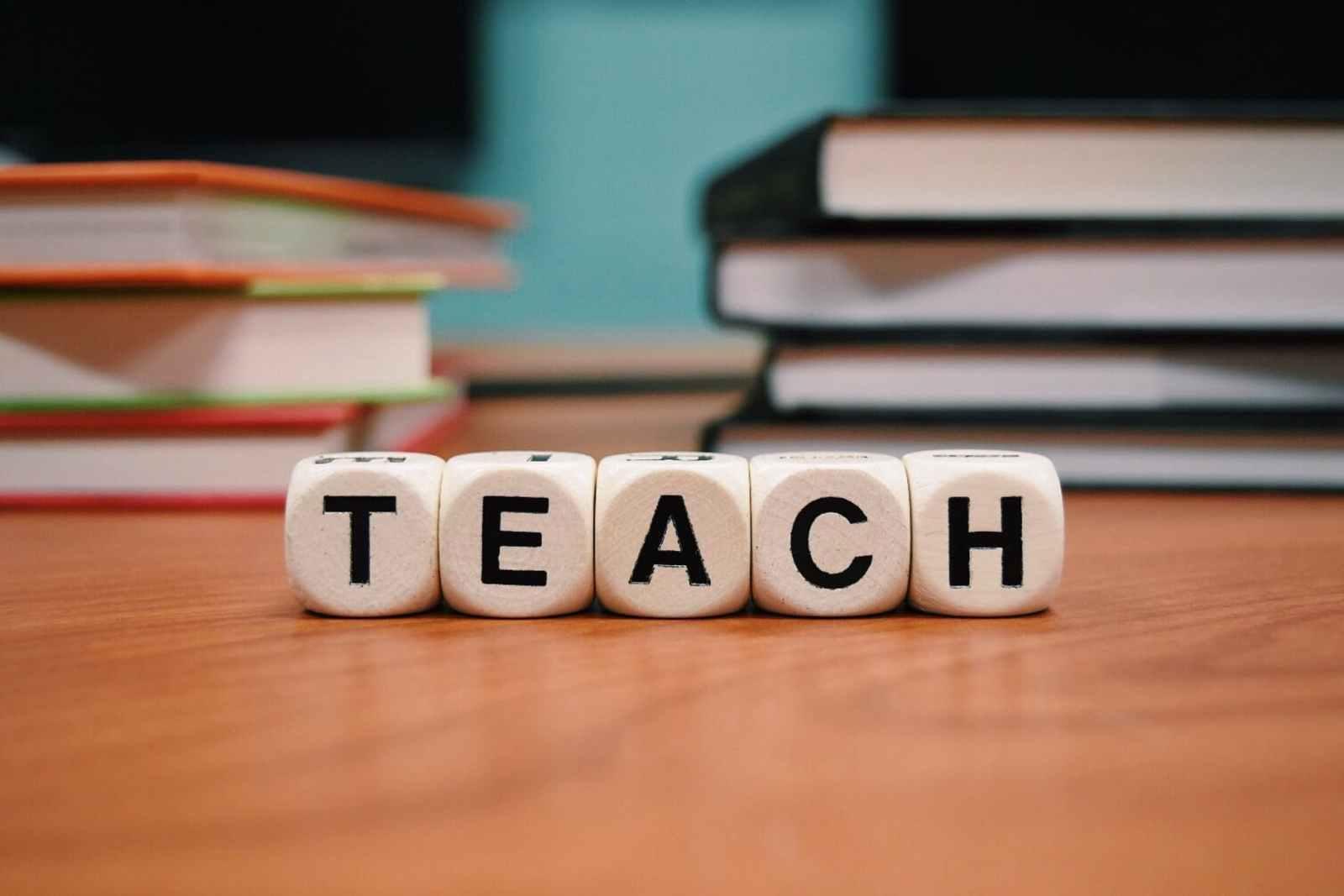 "Blocks arranged to spell ""teach"""
