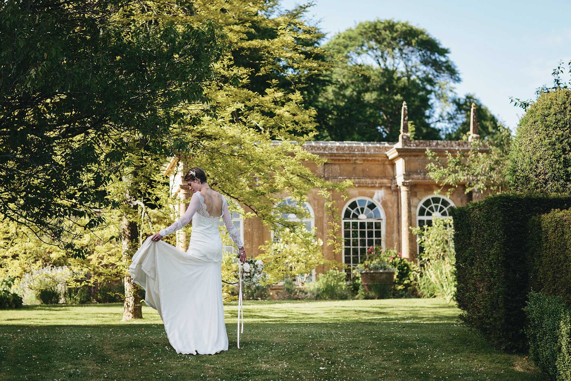 A bride in front of The Orangery at Mapperton Gardens - Dorset wedding venue