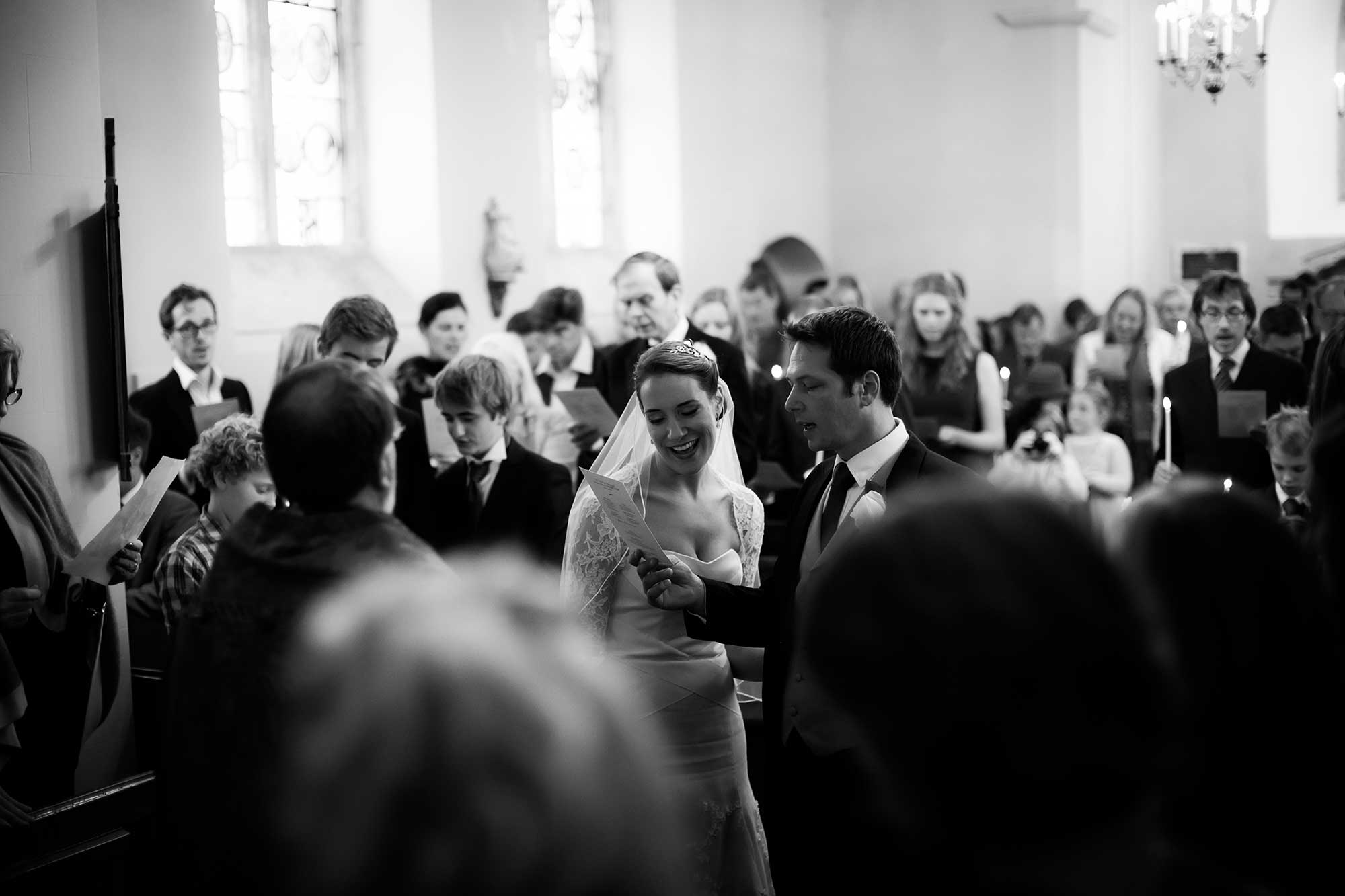A congregation sing in Mapperton's church - Dorset wedding venue