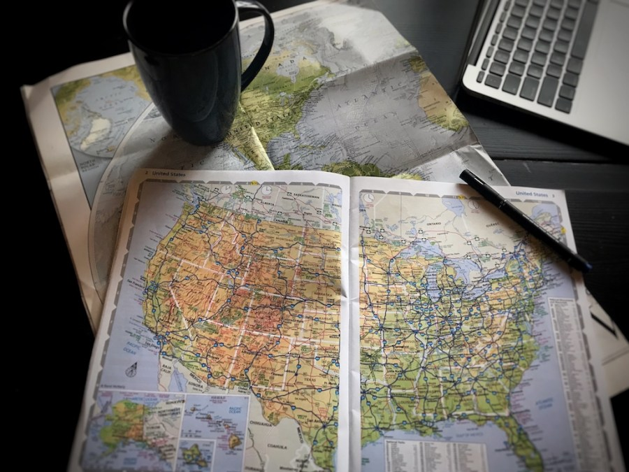 Maps With Coffee and Laptop