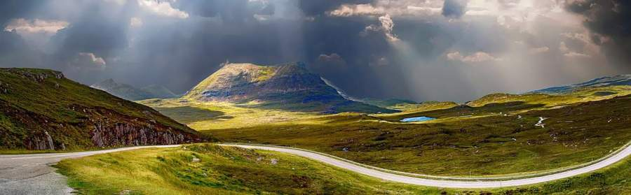 plan a road trip on this countryside, road, journey, sun rays peeking through clouds