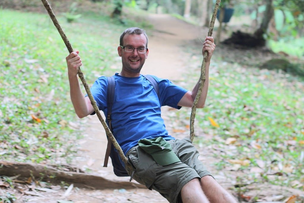 Swinging in a tree branch near Khun Korn Waterfall, Chiang Rai, Thailand