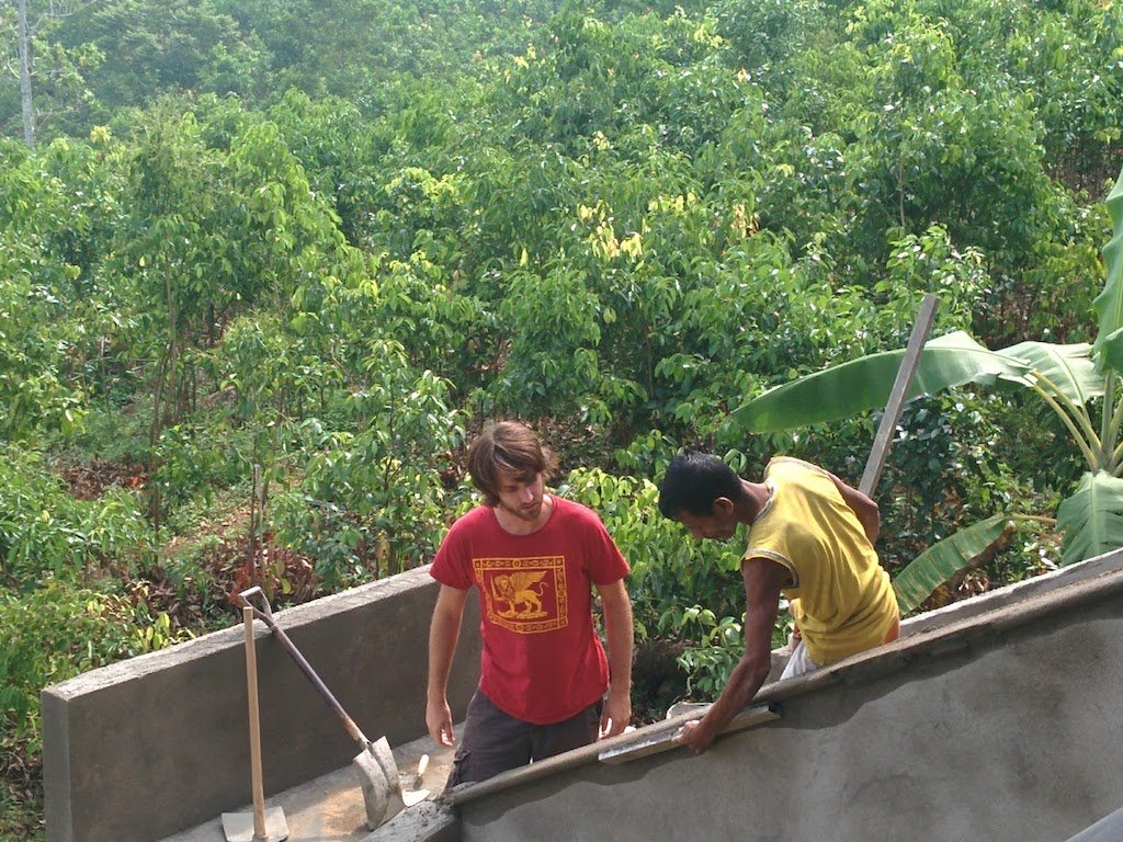 helping make cement stairs house sitting