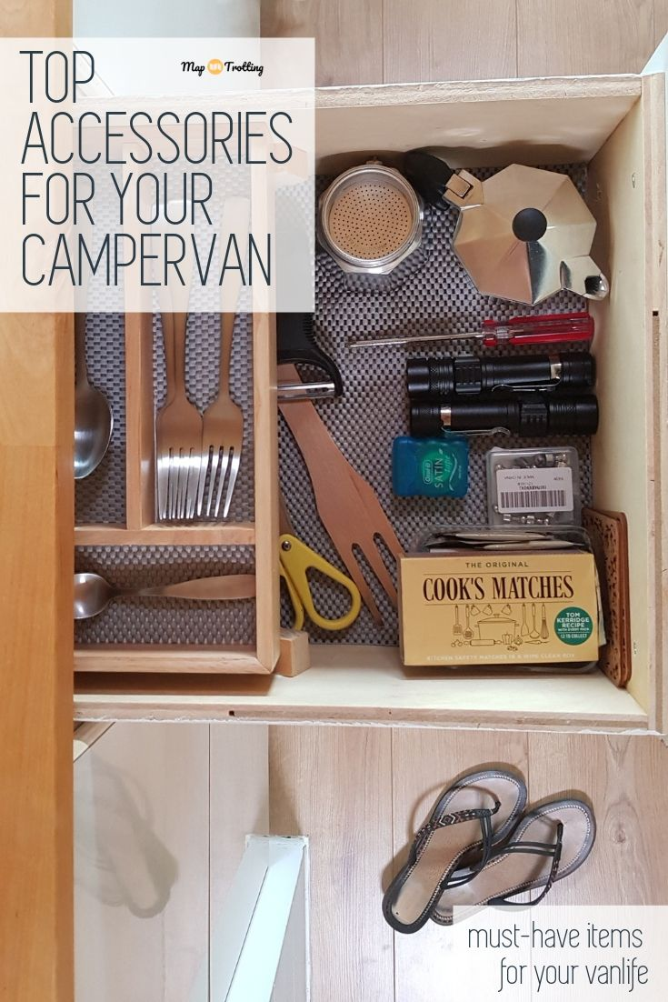 An open draw full of campervan accessories for functional kitchen: real cutlery, small Italian coffee maker, two LED torches, scissors, screw driver, cooking utensils + flip-flops on the floor and a blue&white stripy tea towel on a hook.