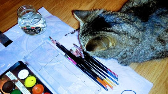The cat chases brushes