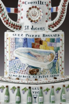 "Mara Superior, ""Belle France"", 2005, 22"" x 19"" x 8.5"", high-fired porcelain, ceramic oxides, underglaze, glaze, wood base, gold leaf, bone label, brass pins."