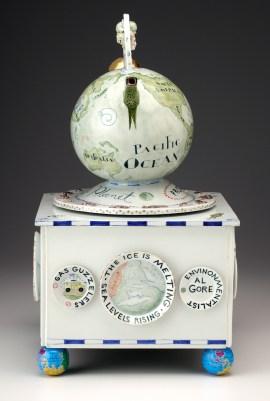 "Mara Superior, ""Smart Planet: Homage to Science"", 2009, 20 x 10.5 x 10.5"", high-fired porcelain, ceramic oxides, underglaze, glaze, wood, gold leaf, tin pencil-sharpener (feet). Renwick Gallery, Smithsonian American Museum of Art (2019.7.2)."