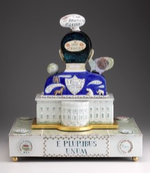 "Mara Superior, ""Obama White House"", 2010, 23 x 20 x 16"", high-fired porcelain, ceramic oxides, underglaze, glaze, wood, gold leaf, bone, ink. RISD Museum (2019.22)."