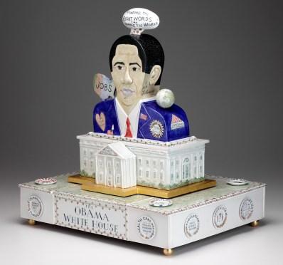 "Mara Superior, ""Obama White House"", 2010, 23 x 20 x 16"", high-fired porcelain, ceramic oxides, underglaze, glaze, wood, gold leaf, bone, ink. RISD Museum (2019.22)."