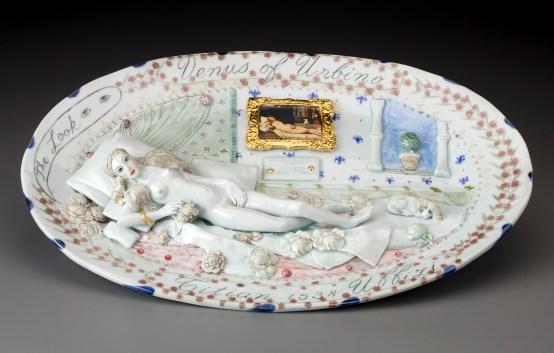 "Mara Superior, ""Venus of Urbino Revived"", 2018, 13 x 19 x 1.75"", high-fired porcelain, ceramic oxides, underglaze, glaze, gold leaf, decal. Chazen Museum of Art (2019.1)."