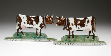 "Mara Superior, ""Pair of Standing Cows"", 1995, 6.5 x 13 x 6"" (each), high-fired porcelain, ceramic oxides, underglaze, glaze."
