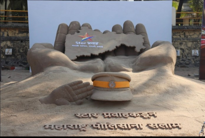Team Nave Lakshya Salutes Police With Sand Sculpture