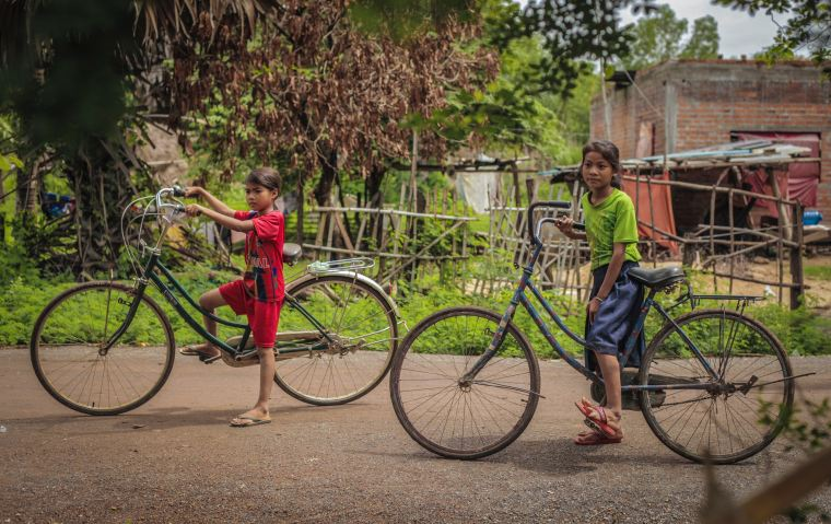Children cycling in Cambodia