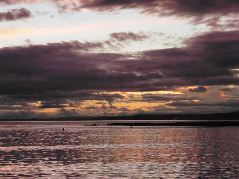 Rain-laden clouded sunset skies
