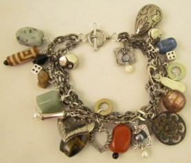 Super chunky, heavy weight assorted charm bracelet.