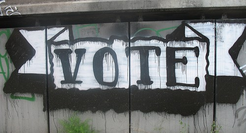 "Hand-painted ""Vote"" sign"