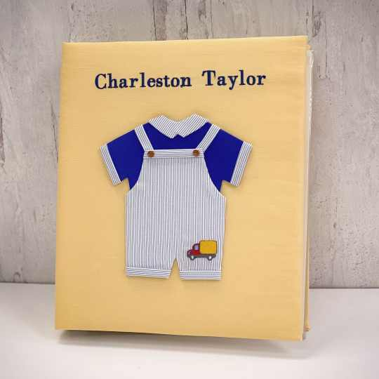 Baby Memory Book In Shantung With Embroidered Truck On Blue Jumper