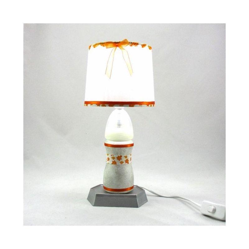 lampe bebe biberon blanc et argente abat jour blanc et orange