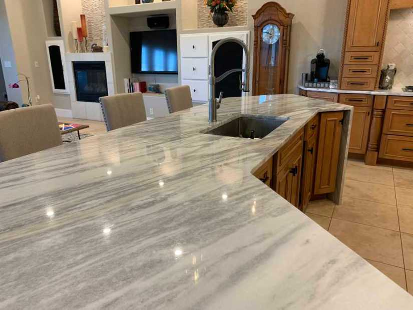 white marble counters and maple wood cabinets