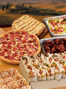 An assortment of menu items on display, including a box of sandwiches, a tin of salad, a tin of chicken wings, CinnaSquares, CheezyBread and a pepperoni and sausage pizza.
