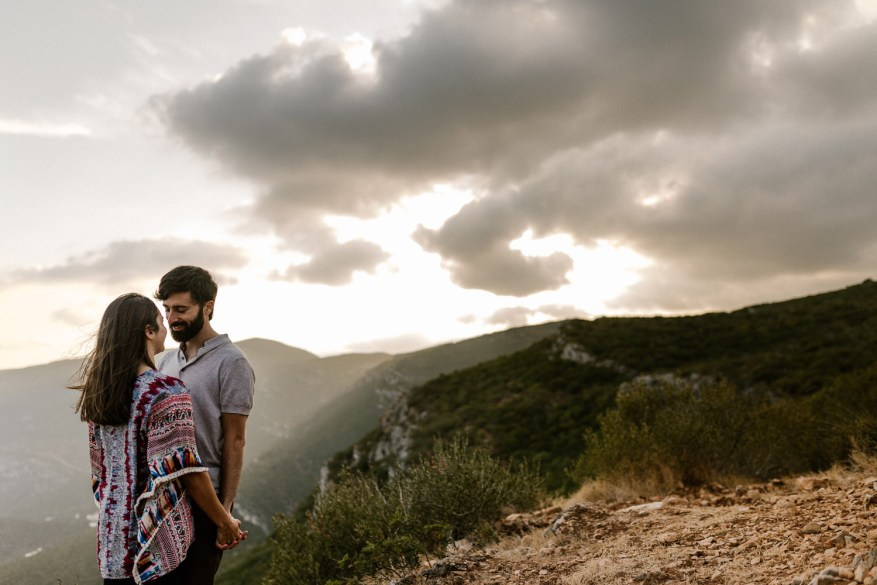 sunset portrait of a young couple in the gorgeous mountains of Portugal