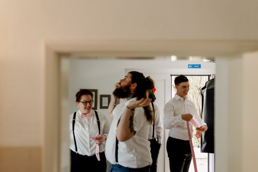 groom and groomsmen get ready for the wedding