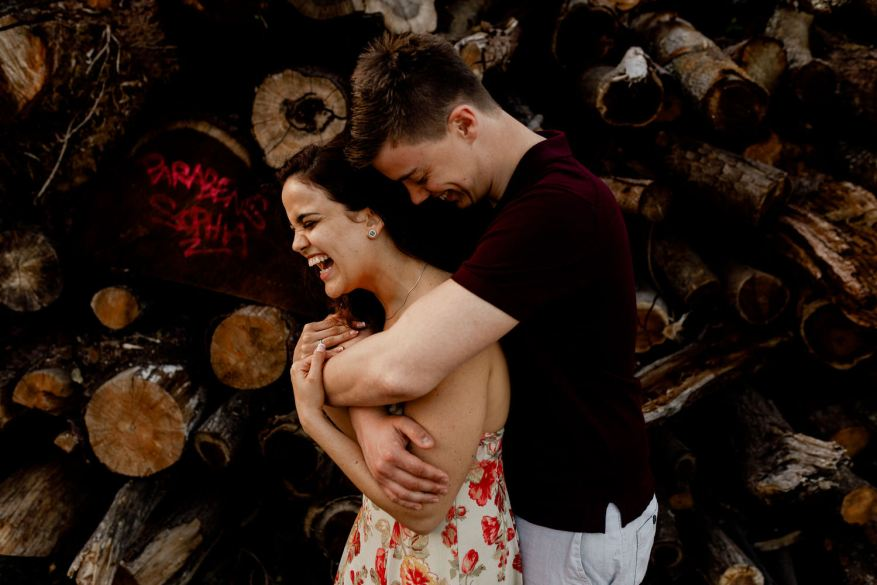 young couple hugs for a portrait taken by marco teixeira photography