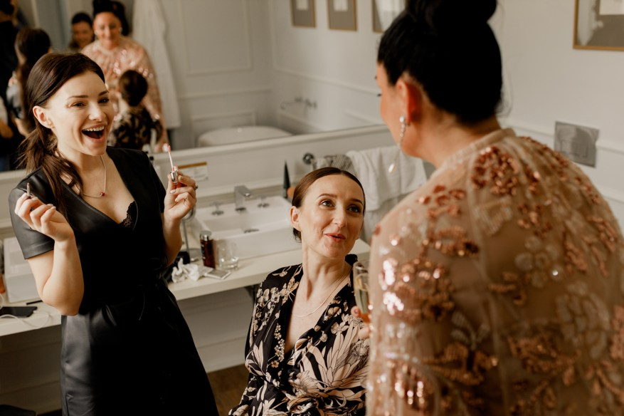 bride laughs with weddding guests
