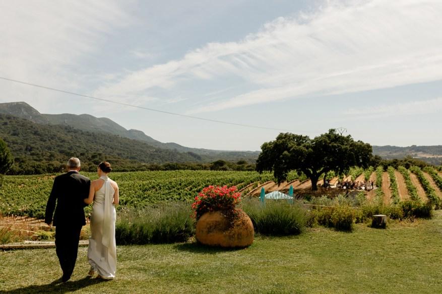 bride walks towards the wedding ceremony at the beautiful hotel casa palmela
