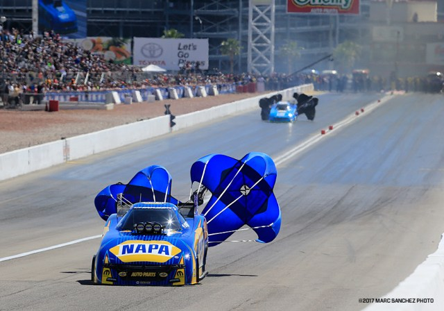 LAS VEGAS, NV - APRIL 01: Ron Capps (1 FC) Don Schumacher Racing (DSR) Dodge Charger NHRA Funny Car deploys a parachute during the NHRA DENSO Spark Plugs NHRA Nationals on April 01, 2017 at the Las Vegas Motor Speedway in Las Vegas, Nevada. (Photo by Marc Sanchez/Icon Sportswire)
