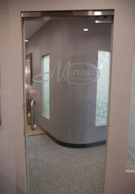 marcis dental front glass door with their logo - Tour The Office