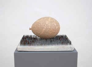 Sculptures by artist Marcus Kleinfeld titled 'Forces', depicting a paper maché balloon on top of cast nails