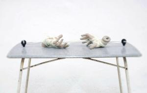 Marcus Kleinfeld, POTENTIAL (Detail, Sculptures), 2011 Table, electrical fencing plugs, electrical wire, mannequin hands 75 x 90 x 60 cm