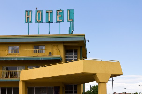 Old Grungy Hotel Sign Above Highway Motel